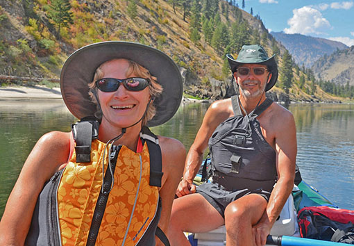 Mary and Curt Remington rafting on a river